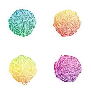 little hippie rainbow yarn balls on white