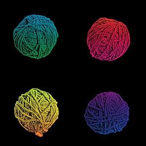 little hippie rainbow yarn balls on black
