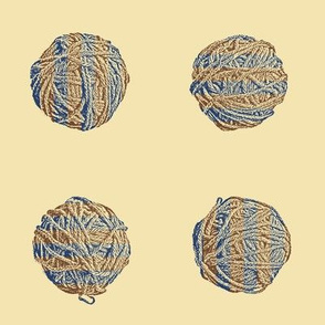 self-striping yarn balls in brown and navy on cream