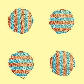 knitting in the sunshine:  self-striping yarn balls in red and cyan on pale gold