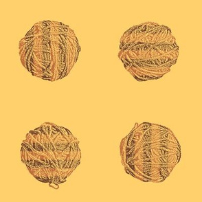 knitting in the morning:  self-striping yarn balls in copper and brown on gold