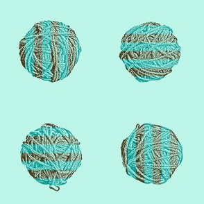 self-striping yarn balls in brown and teal on pale aqua
