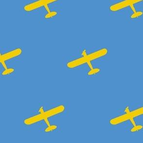 Yellow Propeller Plane Overhead