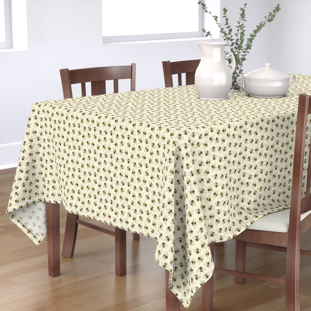 Bantam Rectangular Tablecloth featuring Busy Bees - on pale yellow by hazelfishercreations