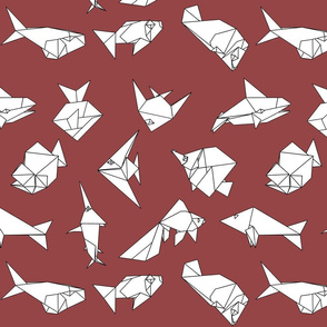 Origami fish folds on burgandy