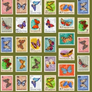 butterfly postage stamps from Hungary, life-sized on olive green