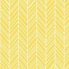 herringbone feathers butter yellow