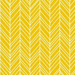 herringbone feathers mustard yellow