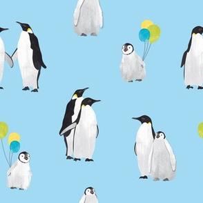 Penguin family on blue