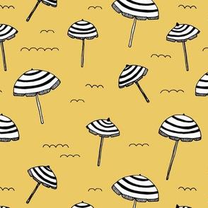 Day at the beach sun screen tropical parasol umbrella sun yellow