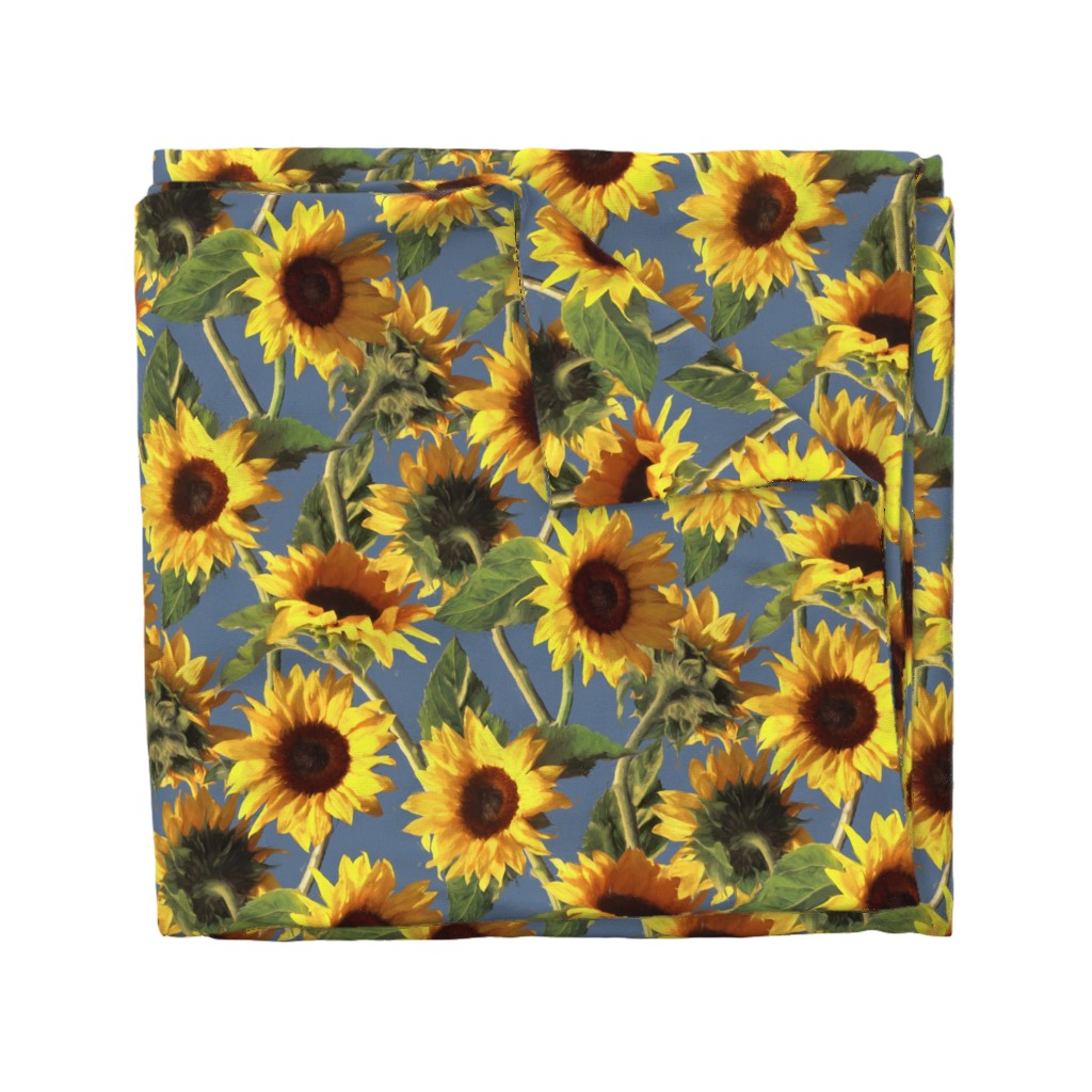 Wyandotte Duvet Cover featuring Sunflowers on Light Blue by micklyn