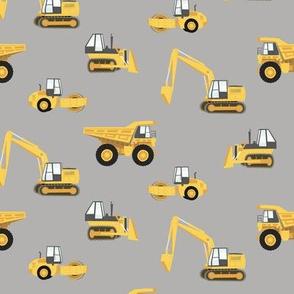 construction trucks - yellow on grey