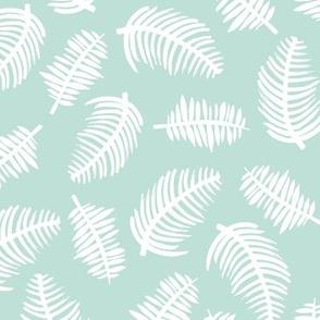 Tropical summer palm leaves garden mint green