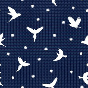 White flying birds on dark blue