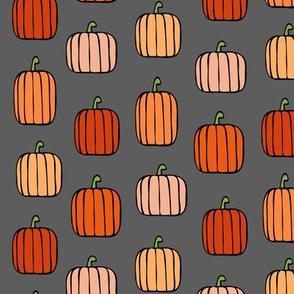 orange pumpkins on charcoal