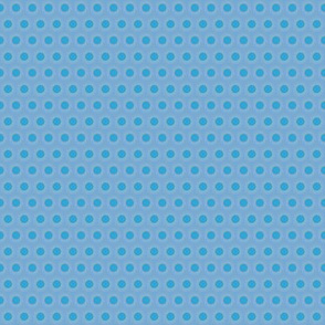 Mid-Tone Blue Polka Dot with Tan Feathered edge on a Field of Light Blue
