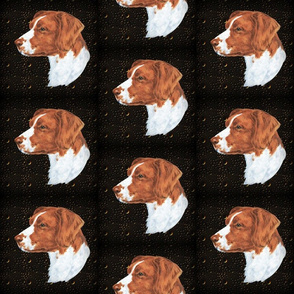 Brittany spaniel dog on metal relief