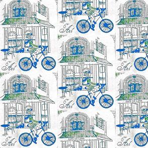 Girl on bike green blue
