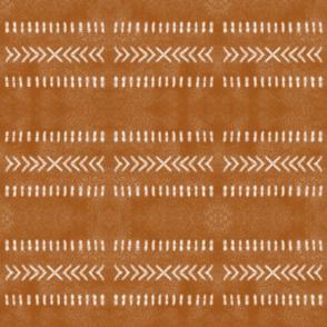 Minimal Tribal Design on Burnt Orange