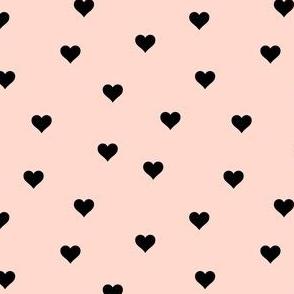 Random black hearts on blush pink