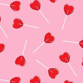 heart shaped suckers - lollipops red on pink