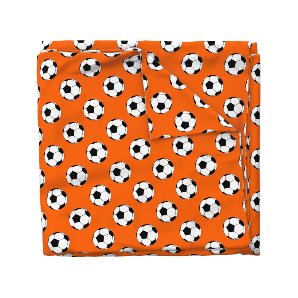 Wyandotte Duvet Cover featuring Three Inch Black and White Soccer Balls on Orange by mtothefifthpower