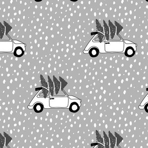 Driving home for Christmas Vintage Fiat 500 christmas tree winter snow wonderland black and white