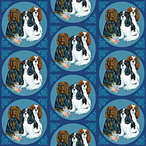 Cavalier King Charles Spaniel dogss on blue tile