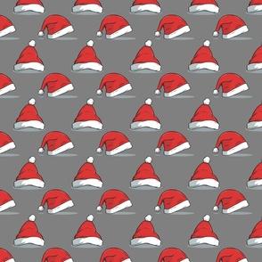Christmas santa hats on gray