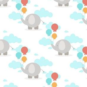 Baby elephant holding balloons