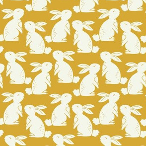 White bunny rabbits in yellow gold