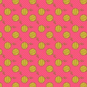 Balls of Yellow Yarn on Pink