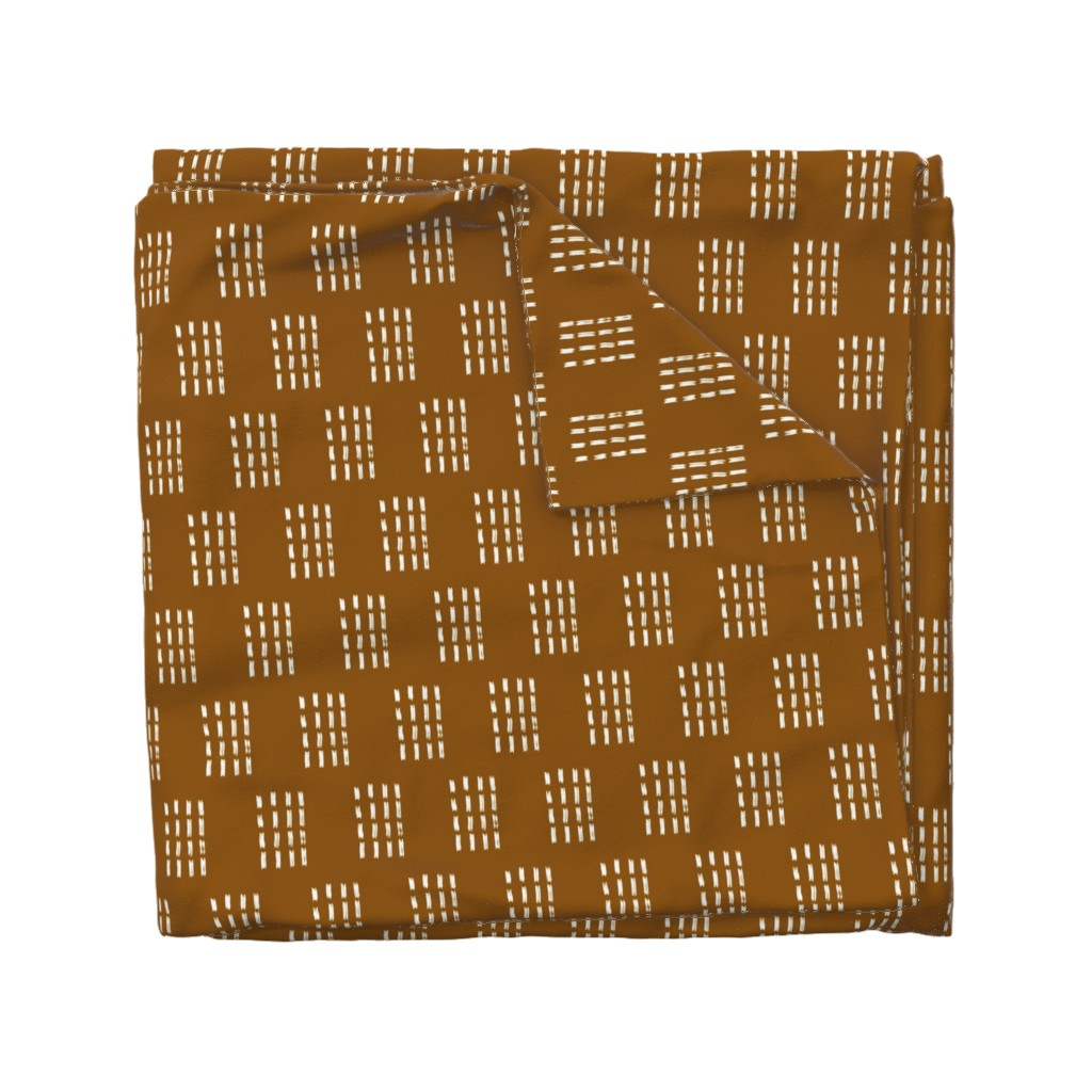 Wyandotte Duvet Cover featuring Copper Mudcloth: Stamped by wilderandbean