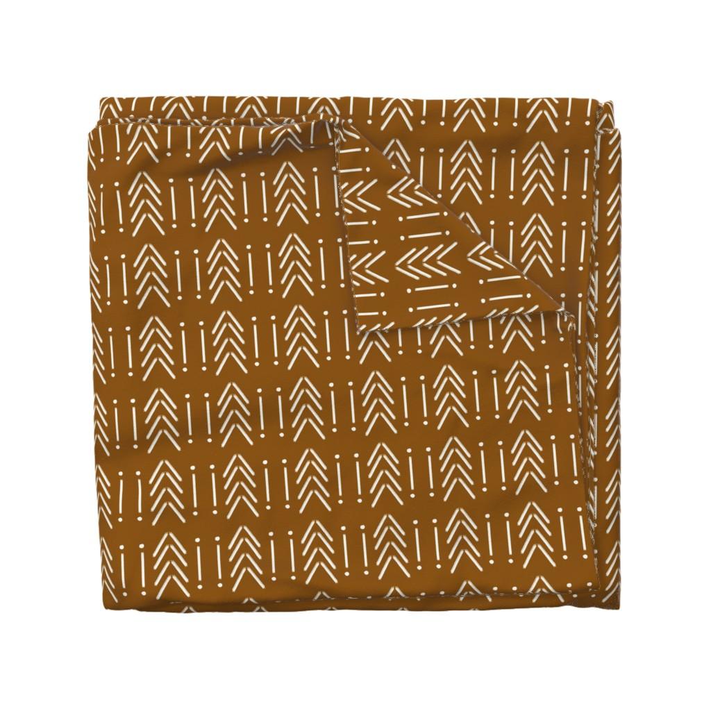 Wyandotte Duvet Cover featuring Copper Mudcloth: Sickle by wilderandbean