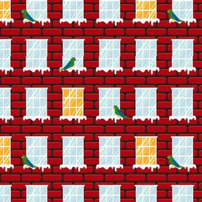 Bird on window of red brick home