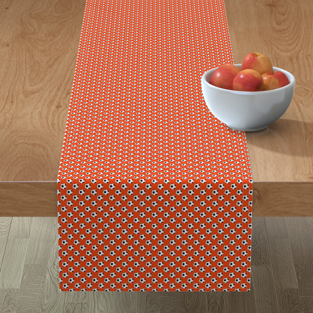 Minorca Table Runner featuring Half Inch Black and White Soccer Balls on Red-Orange by mtothefifthpower