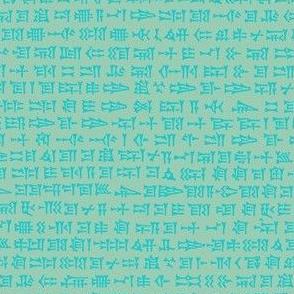 cuneiform writing - bright aqua on sea-green