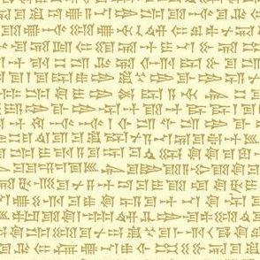 cuneiform writing - tan on cream