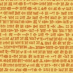 cuneiform writing - orange on gold