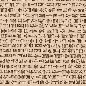 cuneiform writing - brown on driftwood tan