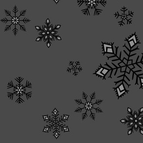 large - snowflakes on charcoal