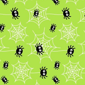 spiders and webs on lime green » halloween rotated