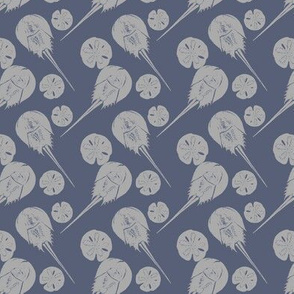 small horseshoe crabs and sand dollars gray on blue