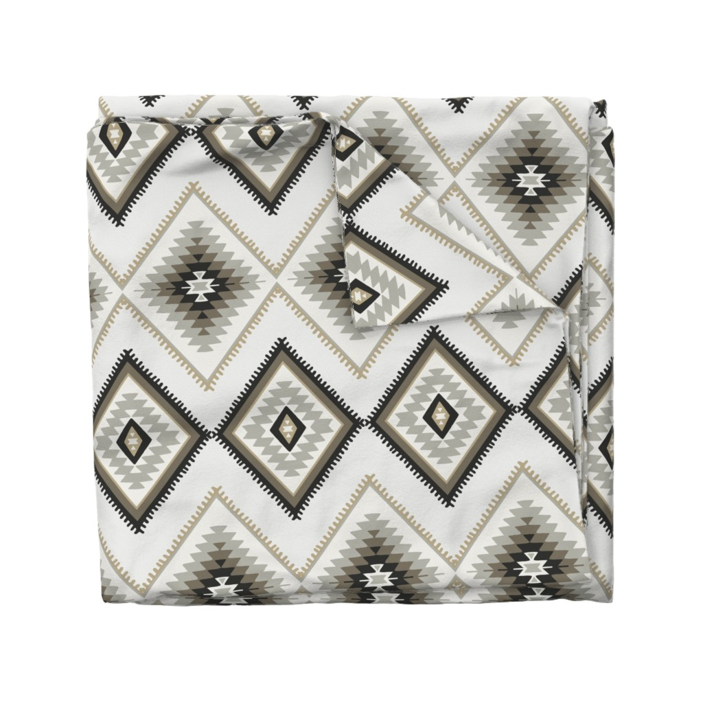Wyandotte Duvet Cover featuring Brown and beige aztec southwestern by thekindredpines