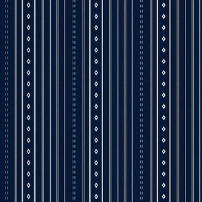 White stripes and diamonds on navy blue