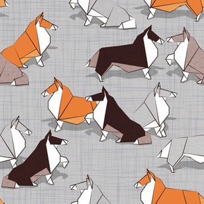 Small scale // Origami Collie friends // grey linen texture background white orange & brown paper and cardboard dogs