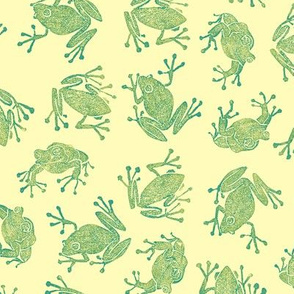 green frogs on pale gold