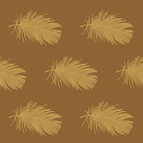 gold feather on caramel brown