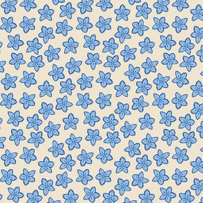 Small blue flowers on cream background