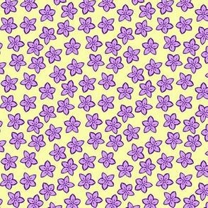 Little purple flowers on pale yellow